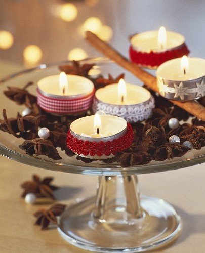 Clever! Clever! Left over lace trim wrapped around tea candles.